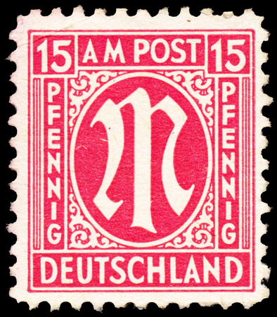 definitive: GERMANY - CIRCA 1945: A stamp printed in American-British occupation zone shows definitive stamp series M in denomination of 15 pfennig, circa 1945