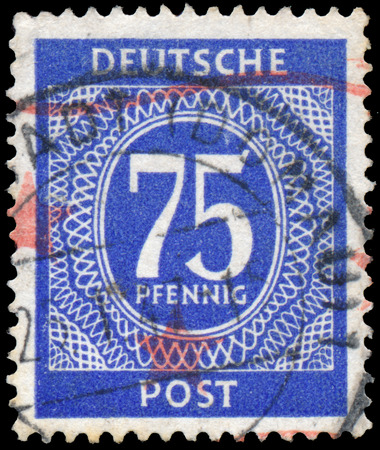 west of germany: GERMANY- CIRCA 1946: Postage stamp printed in West Germany (FRG) shows a white pattern on blue background. circa 1946