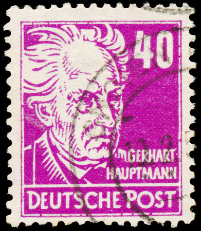 dramatist: GERMANY - CIRCA 1952: Stamp printed in Germany shows portrait of Gerhart Hauptmann (dramatist and novelist), with the same inscription, from the series Famous People, circa 1952