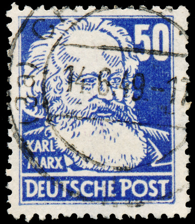 marx: GERMANY - CIRCA 1952: Stamp printed in Germany shows portrait of Karl Marx (German pronunciation), with the same inscription, from the series Famous People, circa 1952