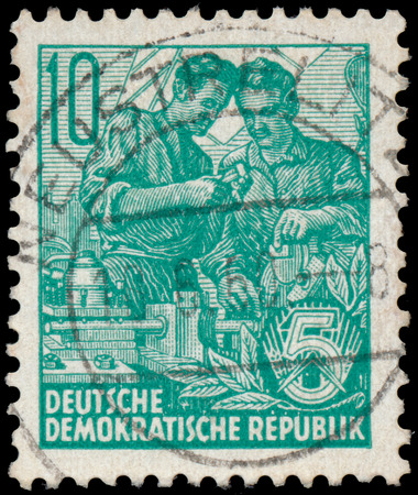 ddr: DDR - CIRCA 1953: A stamp printed in DDR, shows workers, series Five-year plan, circa 1953