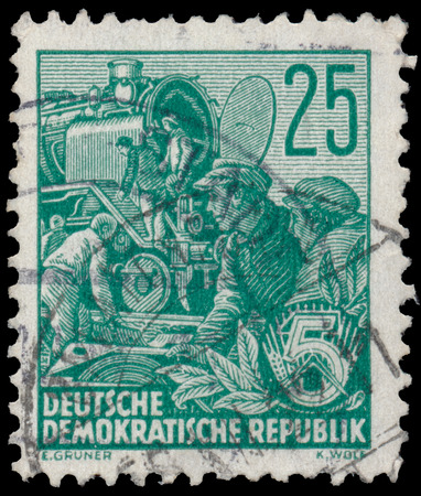 ddr: DDR - CIRCA 1953: A stamp printed in DDR, shows Reconstruction of steam locomotive, series Five-year plan, circa 1953