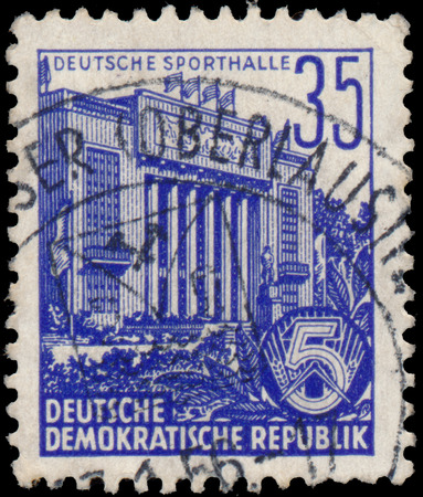 ddr: DDR - CIRCA 1953: A stamp printed in DDR, shows sports hall, series Five-year plan, circa 1953