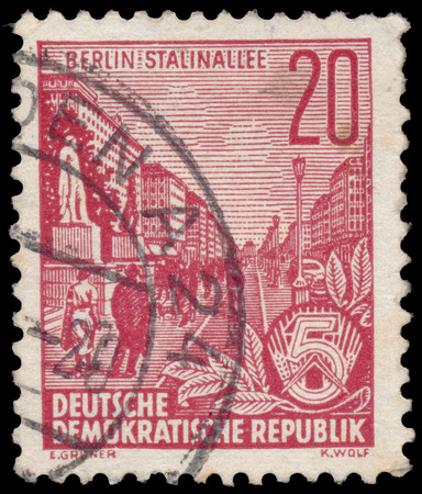 ddr: DDR - CIRCA 1955: A stamp printed in DDR, shows Stalin Avenue with inscription ?Berlin, Stalin Avenue?, series Five-year plan, circa 1955