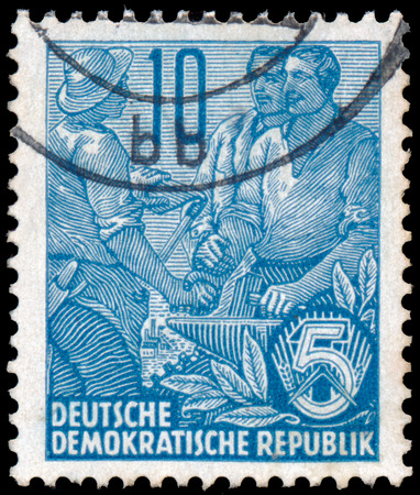 ddr: DDR - CIRCA 1955: A stamp printed in DDR, shows workers, series Five-year plan, circa 1955