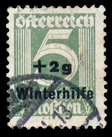 AUSTRIA - CIRCA 1933: A stamp printed in Austria shows image of the number 5 and Winterhelp, circa 1933. photo
