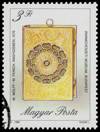 circa: HUNGARY - CIRCA 1990: Stamp printed in Hungary, shows Book-shaped Traveling Clock, by M. Fenich and M. Wolff, 1576, with the same inscription, from series Antique Clocks, circa 1990