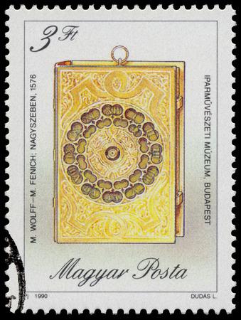 """orologi antichi: UNGHERIA - CIRCA 1990: timbro stampato in Ungheria, mostra Libro a forma di viaggio Clock, da M. Fenich e M. Wolff, 1576, con la stessa scritta, da serie """"orologi antichi"""", circa 1990 Editoriali"""
