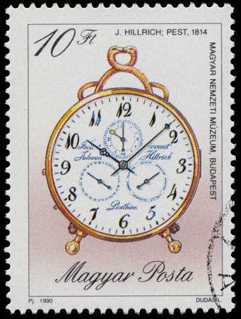 circa: HUNGARY - CIRCA 1990: Stamp printed in Hungary, shows clock by J. Hillrich, 1814, with the same inscription, from series Antique Clocks, circa 1990