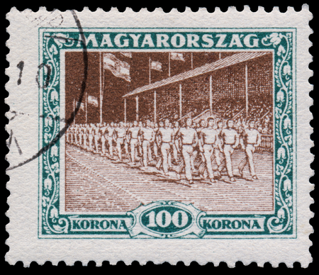 circa: HUNGARY - CIRCA 1925: A stamp printed in Hungary shows marchers from the first hungarian Sport issue, circa 1925