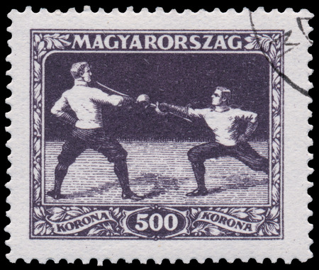 fencers: HUNGARY - CIRCA 1925: A stamp printed in Hungary shows fencers from the first hungarian Sport issue, circa 1925 Editorial
