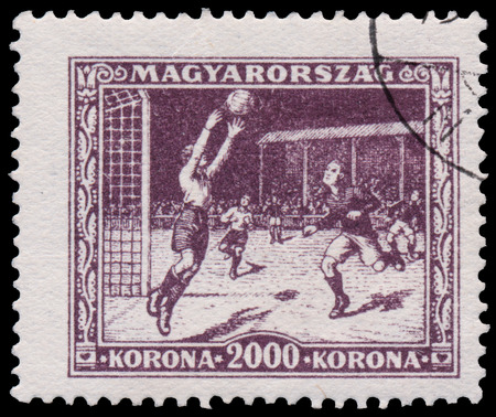 ancient olympic games: HUNGARY - CIRCA 1925: A stamp printed in Hungary shows soccer from the first hungarian Sport issue, circa 1925