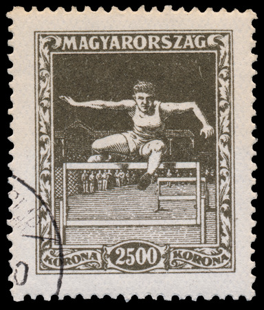ancient olympic games: HUNGARY - CIRCA 1925: A stamp printed in Hungary shows hurdler from the first hungarian Sport issue, circa 1925