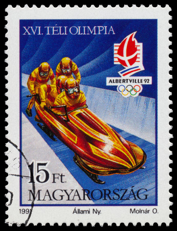 circa: HUNGARY - CIRCA 1991: Stamp printed in Hungary shows Bobsled at the Winter Olympic Games in Albertville in 1992, circa 1991