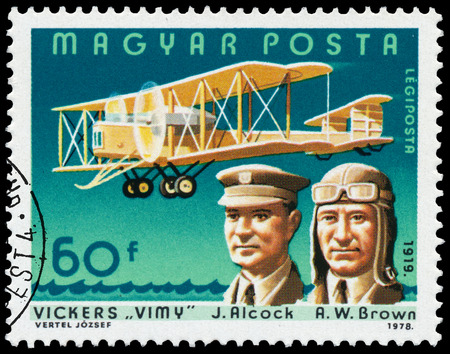 vickers: HUNGARY - CIRCA 1978: Stamp printed in Hungary shows John Alcock and Arthur Whitten Brown with Vickers \Vimy\, the same inscription, series \Famous Aviators and their Airplanes\ circa 1978 Editorial