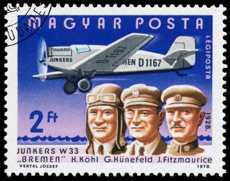 aviators: HUNGARY - CIRCA 1978: Stamp printed in Hungary shows H. K?hl, G. H?nefeld, J. Fitzmaurice with Junkers W33 Bremen, the same inscription, series \Famous Aviators and their Airplanes\ circa 1978