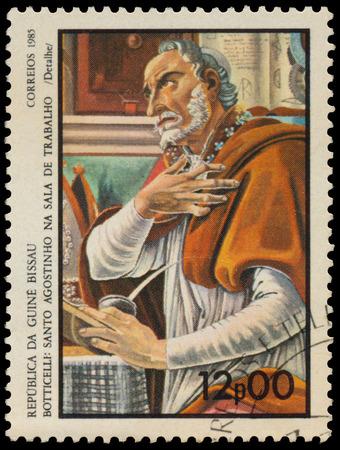 guinea bissau: GUINEA BISSAU - CIRCA 1985: Stamp printed in Guinea-Bissau shows St. Augustine by Botticelli, circa 1985