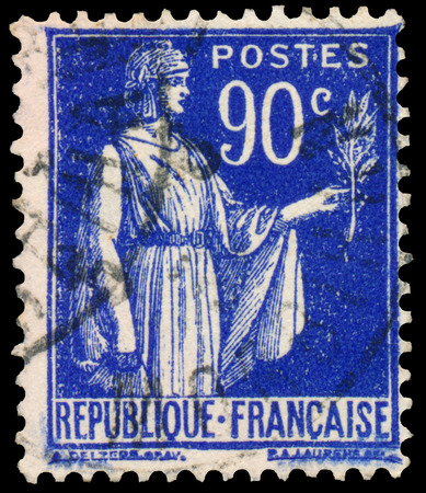 allegory: FRANCE - CIRCA 1932: Stamp printed in France shows a woman with an Olive Branch in hand - allegory of Peace, circa 1932 Stock Photo