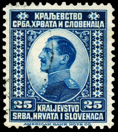 YUGOSLAVIA - CIRCA 1921: A stamp printed in Yugoslavia (Kingdom Serbia, Croatia and Slavonia) shows portrait of King Alexander I of Yugoslavia, wo inscriptions, series King Alexander I, circa 1921