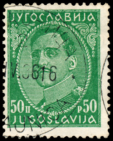 yugoslavia: YUGOSLAVIA - CIRCA 1932: Stamp printed in Yugoslavia shows portrait king Alexander I (1888-1934),  from series King Alexander I, circa 1932