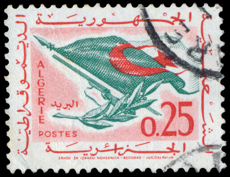 antique rifle: ALGERIA CIRCA 1963: stamp printed by Algeria, shows Flag, Rifle, Olive Branch, circa 1963