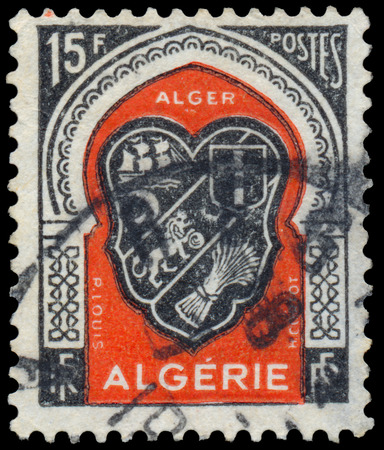 circa: ALGERIA - CIRCA 1947: A stamp printed in Algeria from the Various Arms issue shows Algiers arms, circa 1947