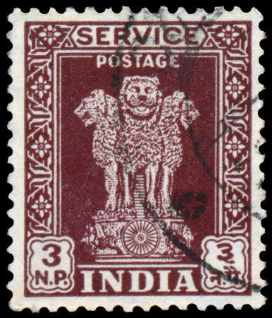 sarnath: INDIA - CIRCA 1958: Stamp printed in India shows four Indian lions capital of Ashoka Pillar, circa 1958.