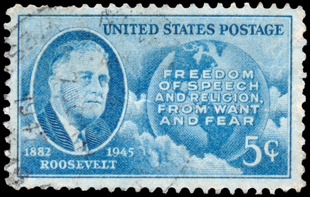 delano: USA - CIRCA 1945: Stamp printed in the USA, shows a portrait of 32th President of the United States, Franklin Delano Roosevelt, Globe and Four Freedoms, circa 1945 Editorial