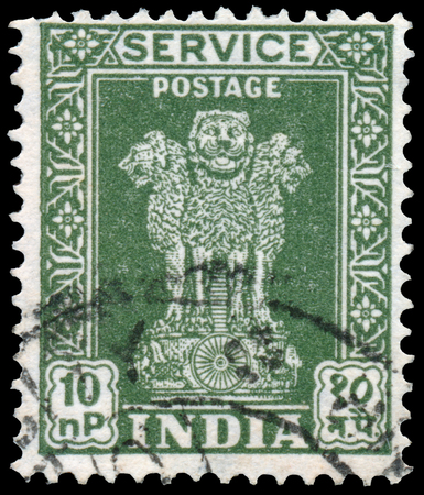 ashoka: INDIA - CIRCA 1958: Stamp printed in India shows four Indian lions capital of Ashoka Pillar, circa 1958.