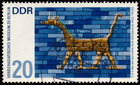 ishtar: GERMANY - CIRCA 1966: Stamp printed in East Germany shows Museum of the Ancient Near East in Berlin, detail from the Ishtar Gate of Babylon , circa 1966