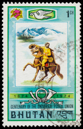 upu: Bhutan - CIRCA 1974: Stamp printed in Bhutan from the 100th Anniversary of UPU issue Shows man on the horse, circa 1974th