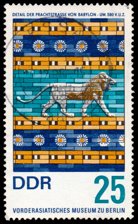 ancient near east: GERMANY - CIRCA 1966: Stamp printed in East Germany shows Museum of the Ancient Near East in Berlin, detail from the Ishtar Gate of Babylon , circa 1966