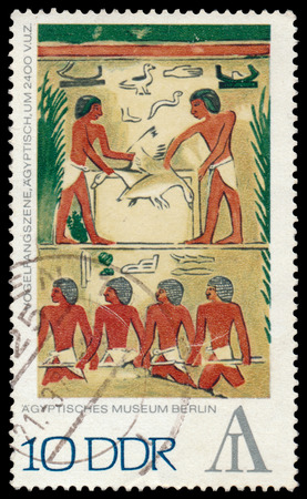 bce: GERMANY - CIRCA 1972: Stamp printed in the Egyptian Museum in Berlin East Germany Shows - Fowling scene, around 2,400 BCE, circa 1,972th