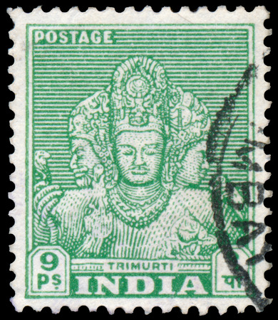 INDIA - CIRCA 1949: Stamp printed by India, shows faces of Trimurti, circa 1949 Editorial