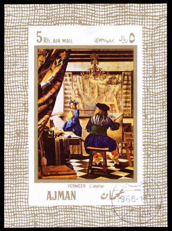 UAE AJMAN - CIRCA 1968: a stamp printed in Ajman UAE Shows the picture The Art of Painting, painted by the famous artist Johannes Vermeer Dutch baroque