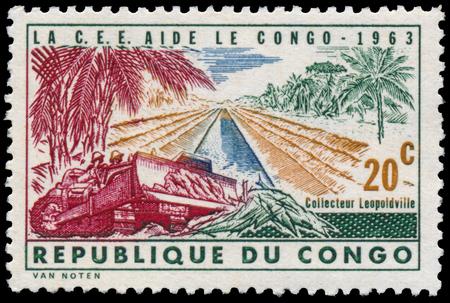 the european economic community: CONGO - CIRCA 1963: a stamp printed in Congo shows construction of road Editorial