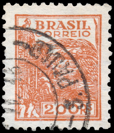 BUDAPEST, HUNGARY - 20 february 2016: a stamp printed in the Brazil shows Wheat harvesting machinery, circa 1941