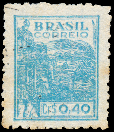 BUDAPEST, HUNGARY - 20 february 2016: a stamp printed in the Brazil shows Wheat harvesting machinery, circa 1946
