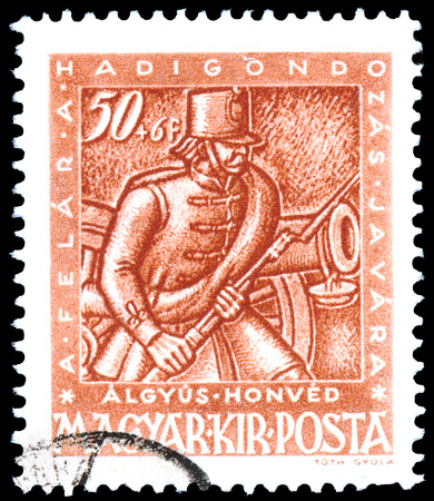 gunner: BUDAPEST, HUNGARY - 03 FEBRUARY 2016: a stamp printed by Hungary, shows gunner with cannon, circa 1943