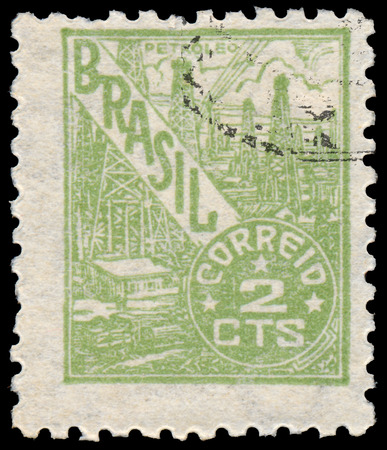 circa: BUDAPEST, HUNGARY - 20 february 2016: a stamp printed in the Brazil shows oil refinery, circa 1946