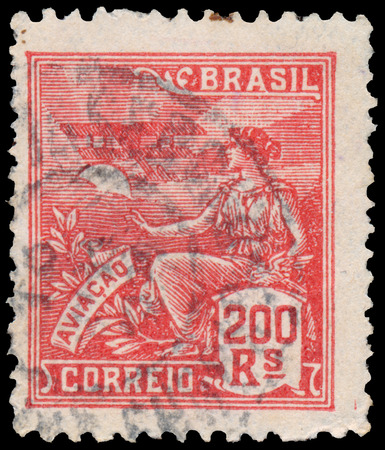 allegory: BUDAPEST, HUNGARY - 20 february 2016: a stamp printed in the Brazil shows woman as allegory aviation, circa 1921
