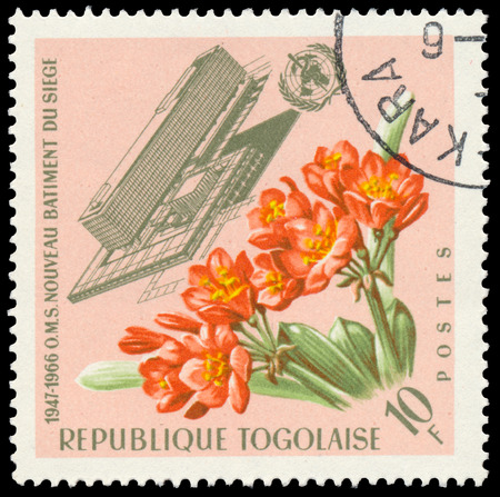 BUDAPEST, HUNGARY - 21 february 2016: a stamp printed in the Togo shows Headquarters of W.H.O. with flowers, circa 1966