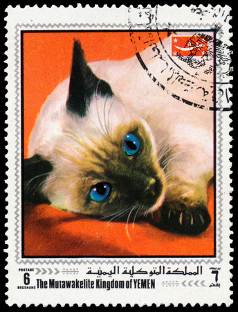dependencies: BUDAPEST, HUNGARY - 01 march 2016:  a stamp printed in Yemen, shows cat, circa 2009