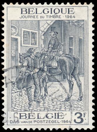 BUDAPEST, HUNGARY - 27 february 2016: a stamp printed in the Belgium shows Postrider, circa 1964 Sajtókép