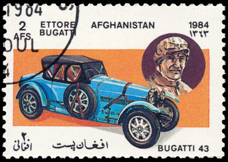 the founder: BUDAPEST, HUNGARY - 18 march 2016:  a stamp printed in Afghanistan shows car Bugatti Type 43 (1927) and portrait of Ettore Bugatti - company founder, series Classic Automobiles, circa 1984