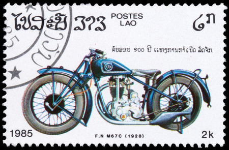 f 18: BUDAPEST, HUNGARY - 18 march 2016:  a stamp printed in Laos from the Centenary of Motorcycle  issue shows F N M67C, 1928, circa 1985