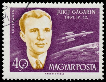 vostok: BUDAPEST, HUNGARY - 14 december 2016:  A stamp printed in Hungary shows soviet cosmonaut Yuri Gagarin and spacecraft Vostok; astronauts series circa 1962