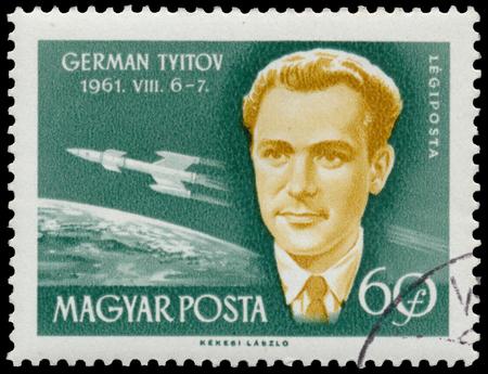 BUDAPEST, HUNGARY - 14 december 2016:  A stamp printed in Hungary shows soviet cosmonaut German Titov; astronauts series circa 1962 Редакционное