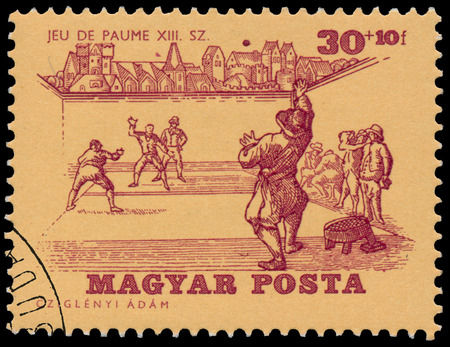BUDAPEST, HUNGARY - 14 december 2016:  A stamp printed by Hungary, shows Tennis of 13th Century, circa 1964 Редакционное