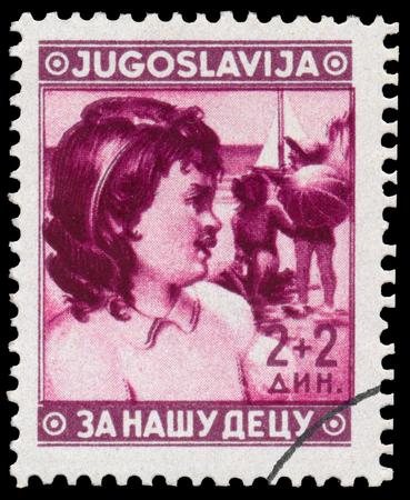 BUDAPEST, HUNGARY - 27 february 2016: stamp printed in Yugoslavia, shows children, circa 1940 Редакционное